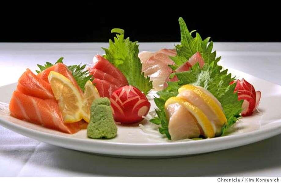 Ken's Sashimi Plate features striped jack, tuna, amberjack, salmon and scallops. Chronicle photo by Kim Komenich