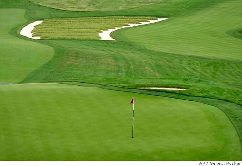 ** ADVANCE FOR WEEKEND EDITIONS, JUNE 9-10 ** This is the church pew bunker that lines the left side of the third fairway at Oakmont Country Club in Oakmont, Pa., the site of the 107th U.S. Open Championship, Tuesday, June 5, 2007. (AP Photo/Gene J. Puskar) Photo: Gene J. Puskar