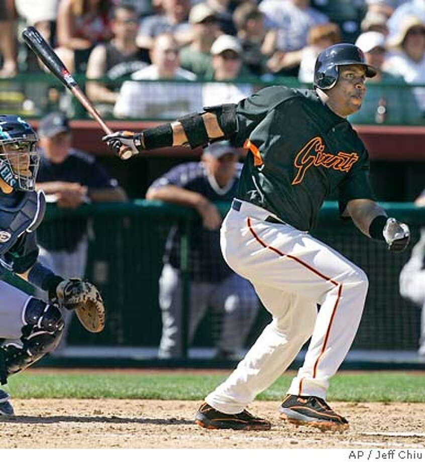 San Francisco Giants' Barry Bonds swings on his fielder's choice against the Seattle Mariners in the fourth inning of a spring training baseball game in Scottsdale, Ariz., Sunday, March 11, 2007. (AP Photo/Jeff Chiu) Photo: Jeff Chiu