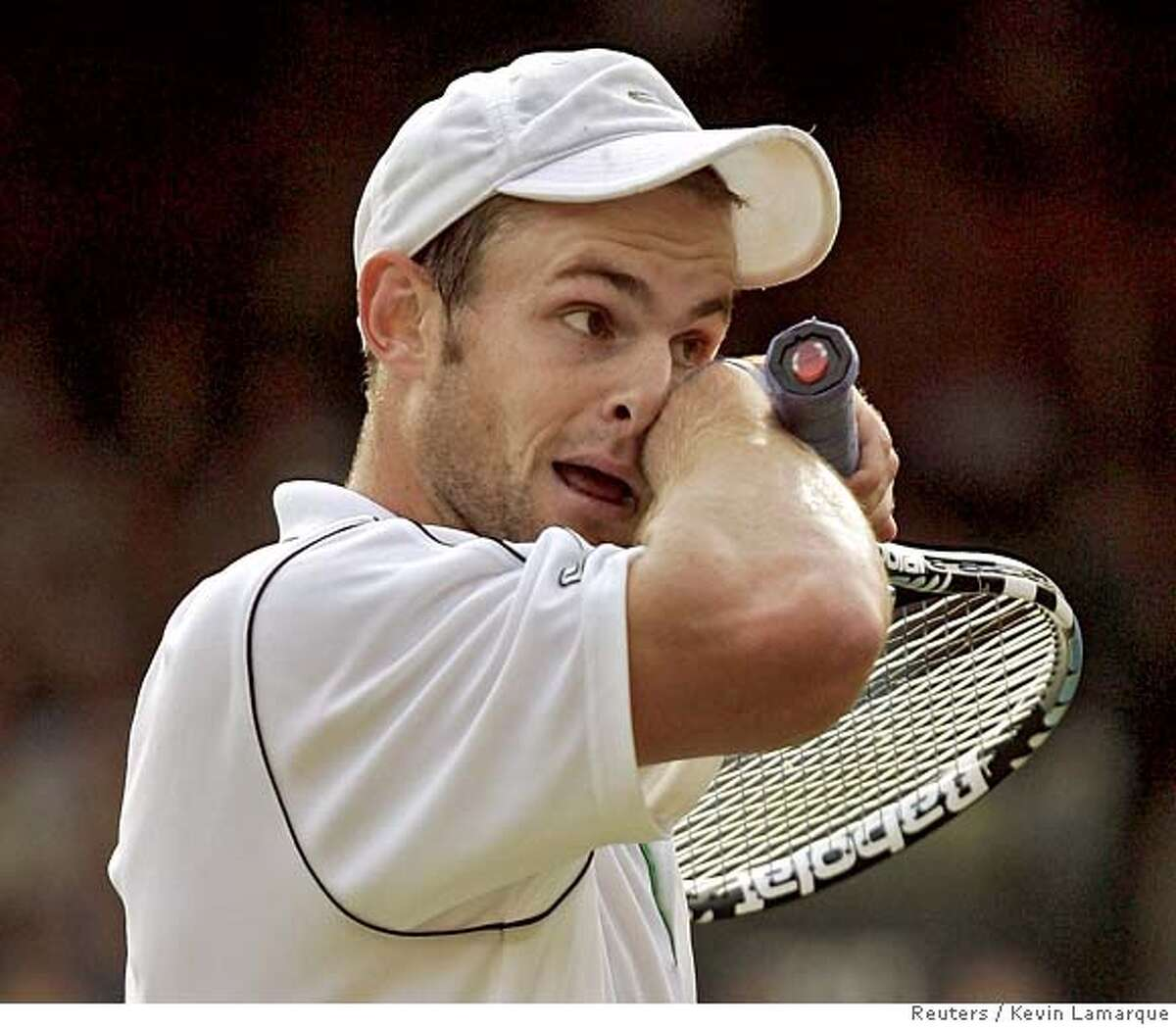 Roddick of US reacts during his match with Britain's Murray at Wimbledon tennis championships in London