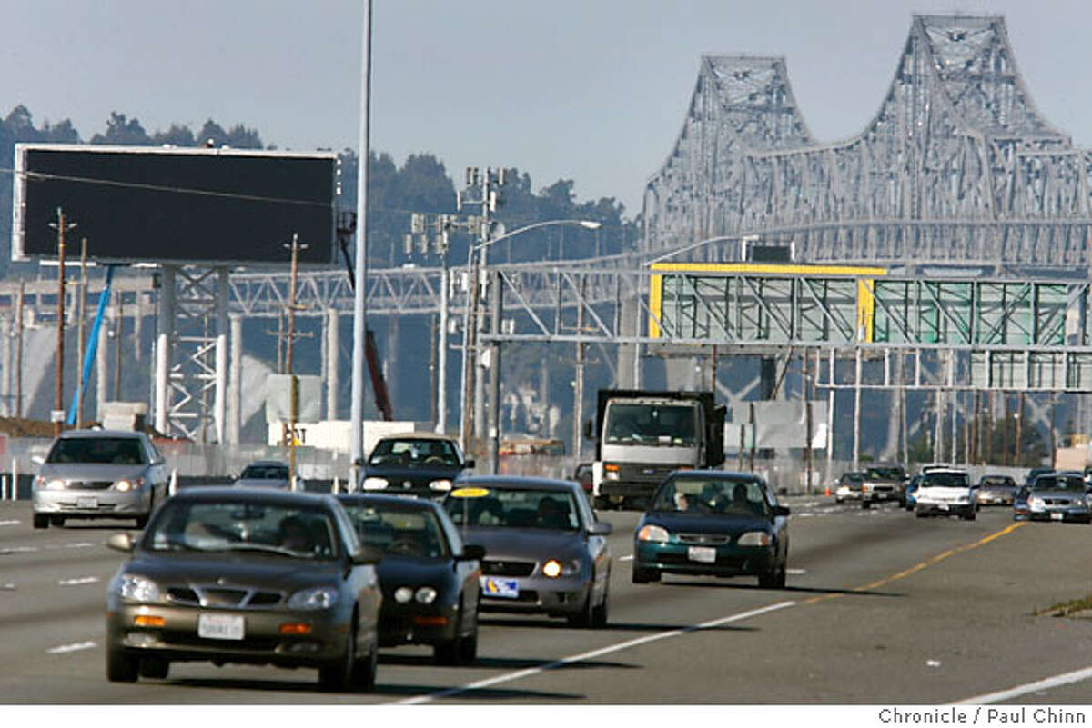 Eastbound traffic speeds past an electronic billboard (left) under construction near the Bay Bridge toll plaza in Oakland, Calif. on Saturday, March 10, 2007. Federal officials are scrutinizing a number of politically connected billboard deals in Oakland. PAUL CHINN/The Chronicle