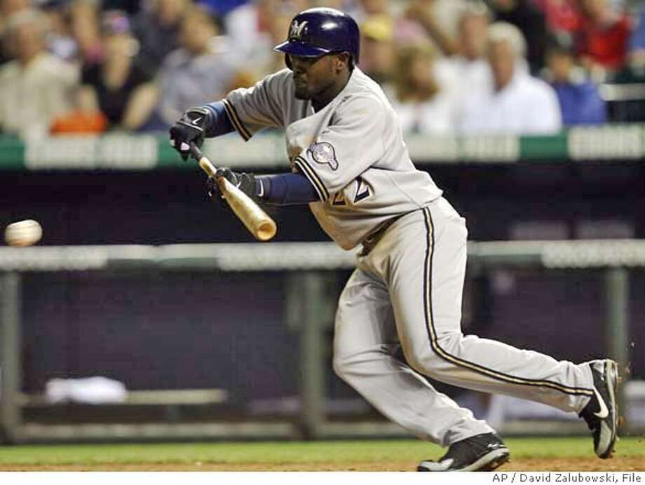 Starting in his first game in the Major Leagues, Milwaukee Brewers' Tony Gwynn Jr. puts down a bunt for a single in the sixth inning of the Brewers' 8-2 loss at the hands of the Colorado Rockies in a baseball game in Denver on Wednesday, Aug. 2, 2006. (AP Photo/David Zalubowski) Photo: DAVID ZALUBOWSKI