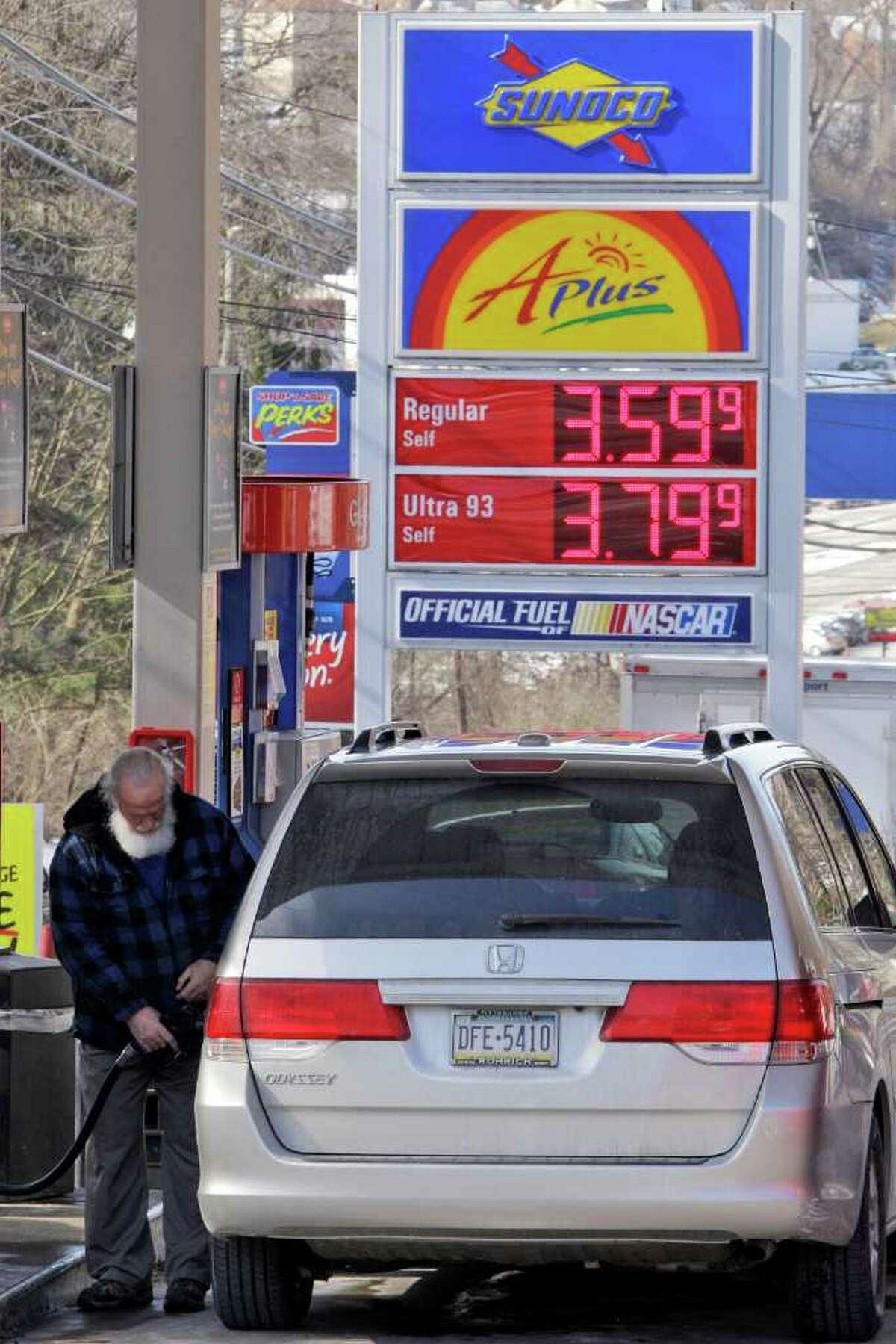 A Pittsburgh driver fills up. Gas sales rose in January; the average Houston price Tuesday was $3.44.