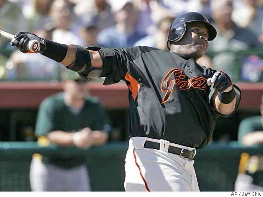 San Francisco Giants' Barry Bonds swings on his solo home run off of Oakland Athletics' Esteban Loaiza in the fourth inning of a spring training baseball game in Scottsdale, Ariz., Friday, March 9, 2007. (AP Photo/Jeff Chiu) Photo: Jeff Chiu