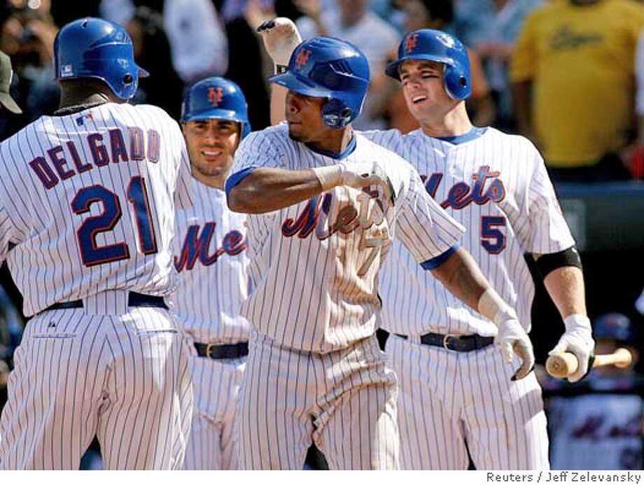 Mets Delgado, Nady, Wright and Reyes celebrate three-run home run off Milwaukee in New York Photo: JEFF ZELEVANSKY