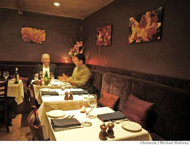 Dining in the intimate back room of Garcon is retired Senator Art Torres (left) and Gonzalo Escudero. For restaurant review of Garcon, 1101 Valencia Street. Photo by Michael Maloney / San Francisco Chronicle on 3/21/06 in San Francisco,CA