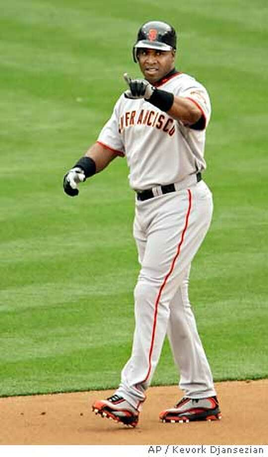 San Francisco Giants Barry Bonds points to center field after hitting a lead off double off San Diego Padres picther Jake Peavey during the second inning of their opening day baseball game at Petco Park in San Diego Monday, April 3, 2006. (AP Photo/Kevork Djansezian) Photo: KEVORK DJANSEZIAN