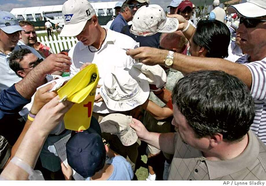 Ernie Els of South Africa stops to sign autographs for fans during a Pro-Am event at the Ford Championship at Doral in Doral, Fla. Wednesday, March 1, 2006. (AP Photo/Lynne Sladky) Photo: LYNNE SLADKY