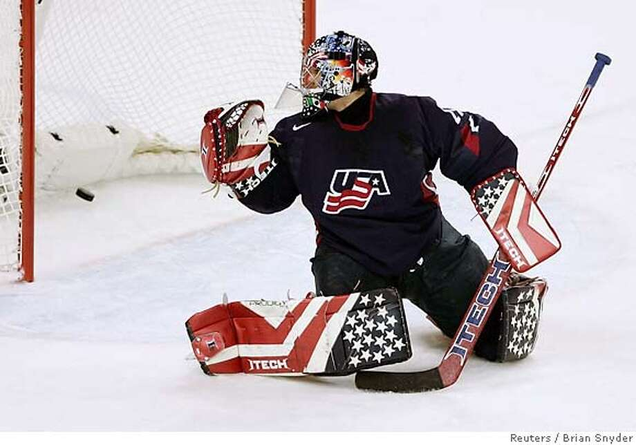 U.S. goalie Rick Dipietro looks back as the puck goes in the net on a shot by Finland's Sami Salo, scoring Finland's second goal, during first period play in their men's quarter-final ice hockey game at the Torino 2006 Winter Olympic Games in Turin, Italy February 22, 2006. REUTERS/Brian Snyder Photo: BRIAN SNYDER