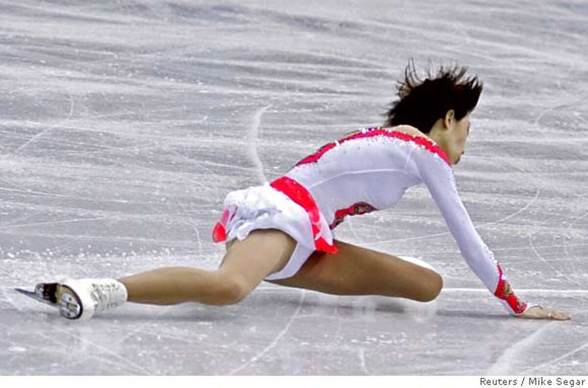 Zhang Dan from China falls during the figure skating Pairs Free Skating at the Torino 2006 Winter Olympic Games in Turin, Italy, February 13, 2006. Zhang Hao and Zhang Dan won the silver medal. REUTERS/Mike Segar 0