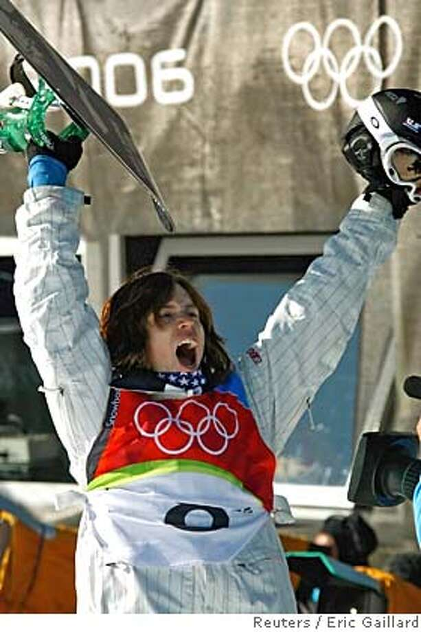 Shaun White of the U.S. celebrates during the final of the men's half pipe snowboarding competition at the Torino 2006 Winter Olympic Games in Bardonecchia, Italy February 12, 2006. REUTERS/Eric Gaillard 0 Photo: ERIC GAILLARD