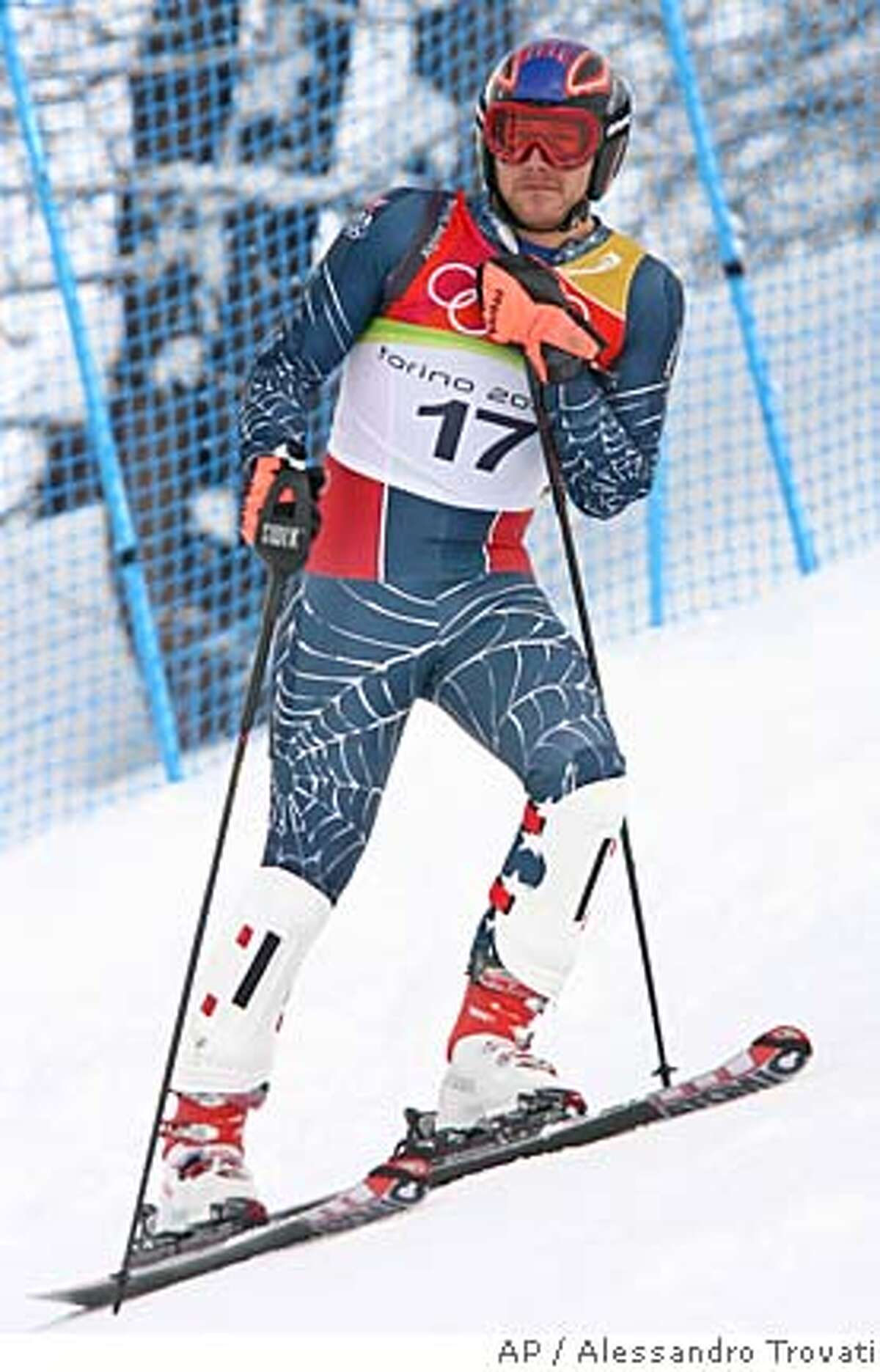 Bode Miller of the United States stands on the side of the course after skiing out on the first run of the Men's Slalom at the Turin 2006 Winter Olympic Games in Sestriere Colle, Italy Saturday Feb. 25, 2006. (AP Photo/Alessandro Trovati)