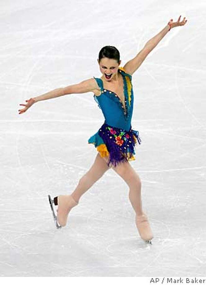 Sasha Cohen, of the United States, celebrates after her Women's Short Program in Turin, Italy during the Turin 2006 Winter Olympic Games on Tuesday, Feb. 21, 2006. Cohen is in first place after the short program by a narrow margin. (AP Photo/Mark Baker) Photo: MARK BAKER