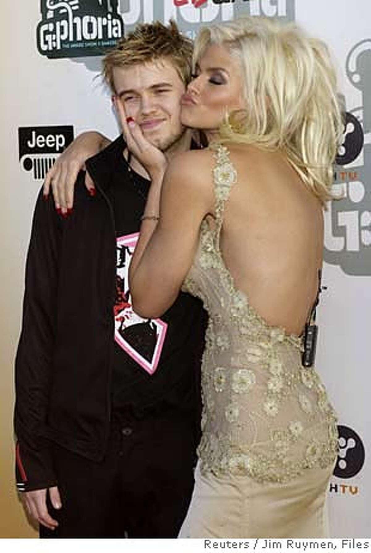 Anna Nicole Smith hugs her son Daniel as they arrive for
