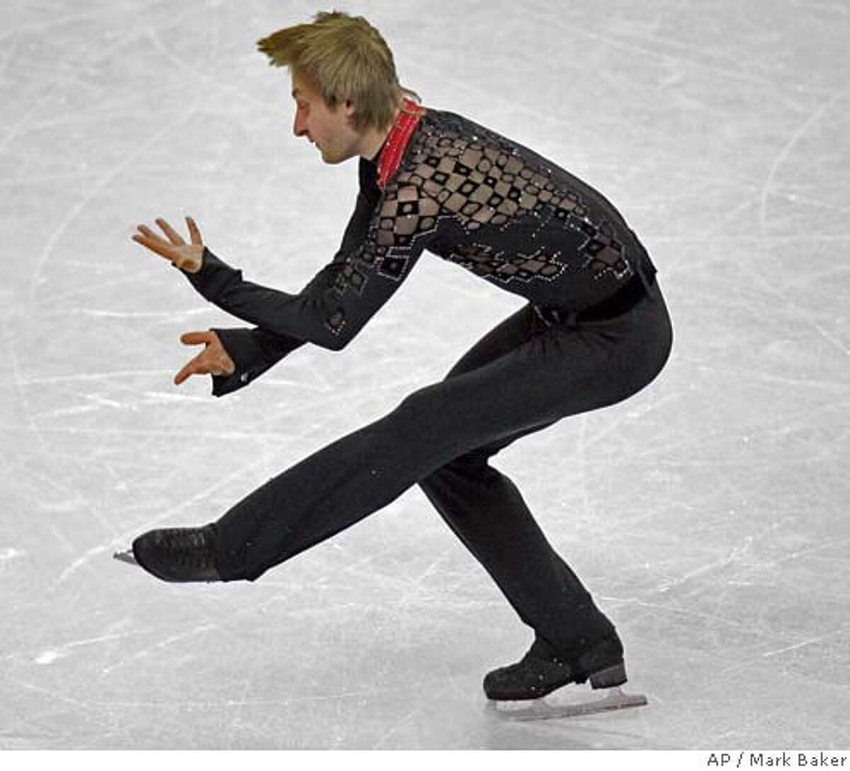 Evgeni Plushenko, of Russia, performs during his routine in the Men's Free Skate in figure skating at the Turin 2006 Winter Olympic Games in Turin, Italy on Thursday, Feb. 16, 2006. (AP Photo/Mark Baker)