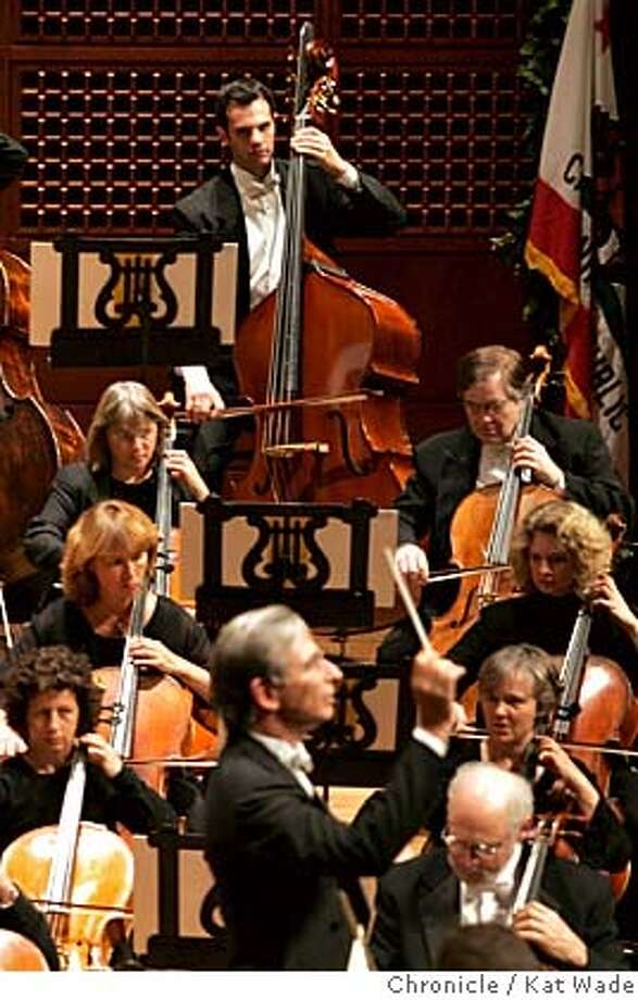 SYMPHONY_136_KW.jpg In San Francisco on 9/9/04 (Bassist Scott Pingel performs with conductor Michael Tilson Thomas opening night of the San Francisco Symphany at Davies Symphony Hall Wednesday evening. Chronicle Photo By Kat Wade Ran on: 09-10-2004 Photo: Kat Wade