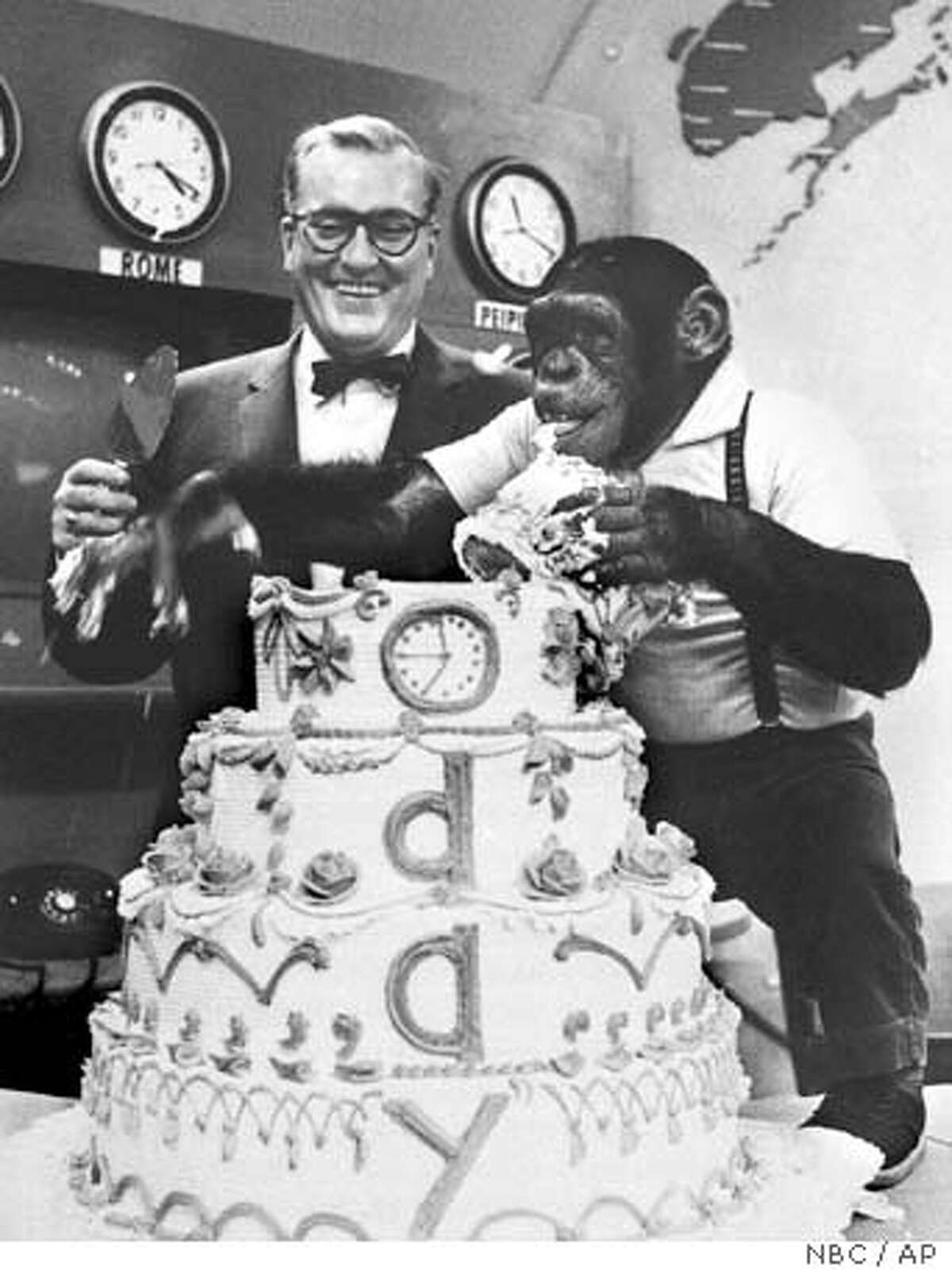 """FILE--Chimpanzee J. Fred Muggs digs into a fifth-anniversary cake for NBC's """"Today"""" show, upstaging anchor Dave Garroway in a live broadcast from New York, in this Jan. 14, 1957, file photo. Monday, a half-century after its dawning on Jan. 14, 1952, """"Today"""" takes a sentimental journey in earnest, looking back on a few of its 13,000 yesterdays during a golden anniversary broadcast from 7 to 10 a.m. EST on NBC. (AP Photo/NBC/FILE) Ran on: 12-26-2006 J. Fred Muggs was Dave Garroways chimpanzee sidekick on the Today show in the early 1950s."""