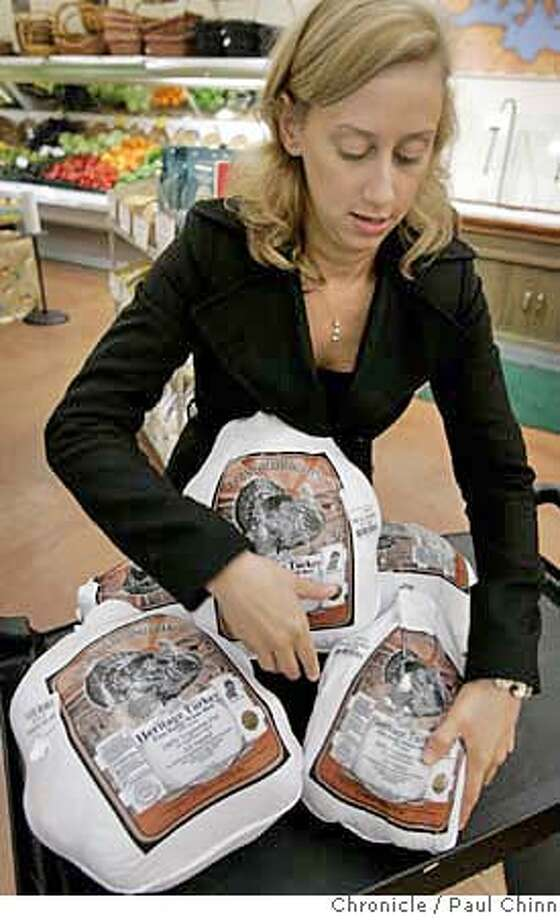 Sara Feinberg organizes Heritage turkeys at the Pasta Shop in Berkeley, Calif. on Friday, Nov. 17, 2006. The special variety of free range bird, which is only available at a handful of Bay Area markets, are sold for $6.99 a pound at the Pasta Shop. Feinberg pre-ordered 25 Heritage turkeys this year - the largest weighing in at 20.6 pounds and costs $144.00.  PAUL CHINN/The Chronicle  **Sara Feinberg MANDATORY CREDIT FOR PHOTOGRAPHER AND S.F. CHRONICLE/ - MAGS OUT Photo: PAUL CHINN