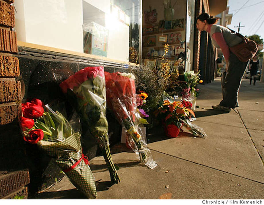 FAMILY08_021_KK.JPG  Christina Madariaga of San Francisco is among friends, customers and acquaintances of James Kim's family who have left flowers, cards and candles at the door of Church Street Apothecary at 1767 Church. It is one of the businesses owned by James and Kati Kim. James Kim died of hypothermia in Oregon last week while trying to find help for his stranded family.  Photo **Christina Madariaga  Ran on: 12-08-2006  Christina Madariaga of San Francisco looks at cards and flowers left at Church Street Apothecary, a business owned by the Kim family. Photo: Kim Komenich