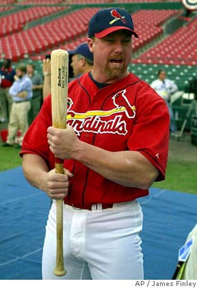 St. Louis Cardinals' Mark McGwire clutches a bat during warmups before Game 2 of the National League Championship Series against the New York Mets at Busch Stadium in St. Louis Thursday, Oct. 12, 2000. (AP Photo/James Finley) Ran on: 03-13-2005  Mark McGwire's reputation may take a blow if he testifies about steroids. Ran on: 03-13-2005  Mark McGwire's reputation may take a blow if he testifies about steroids. Ran on: 03-13-2005  Mark McGwire's reputation may take a blow if he testifies about steroids. Ran on: 03-20-2005  Straw poll indicates Mark McGwire is not a lock to get in or get left out of the hall. Ran on: 03-20-2005  Straw poll indicates Mark McGwire is not a lock to get in or get left out of the Hall. Ran on: 03-20-2005  Straw poll indicates Mark McGwire is not a lock to get in or get left out of the Hall. DIGITAL IMAGE Photo: JAMES. A. FINLEY