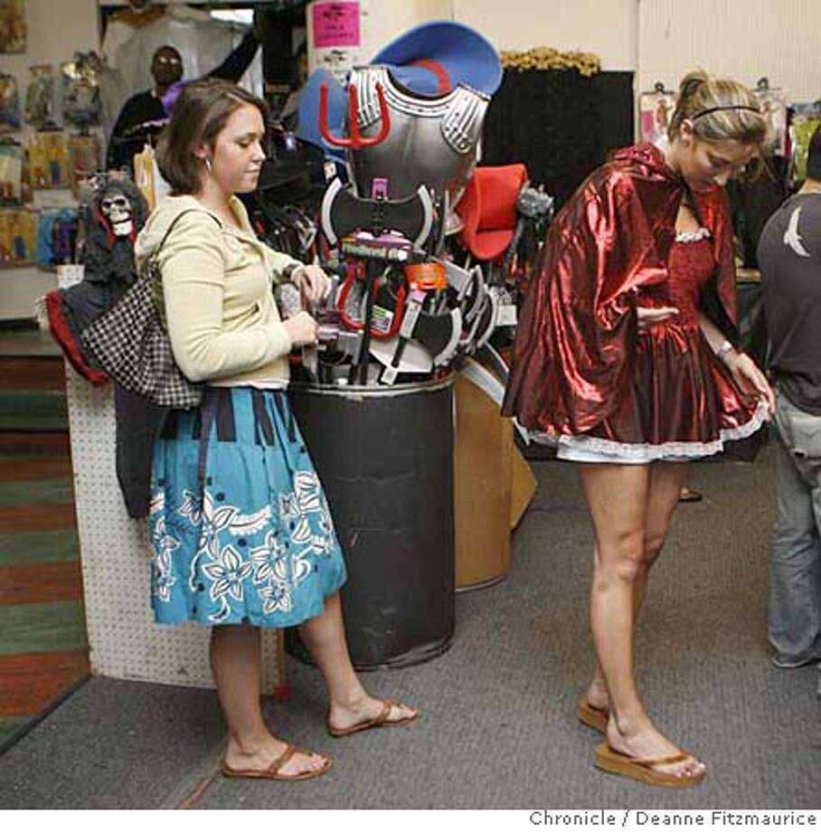 _I8B2860.JPG  At Halloween Headquarters on Market Street, Jenna McGarry, 23, from SF, tries on a Little Red Riding Hood costume but decided that it was too short to buy. At left is her friend, Claire Reilly, 23, from SF. Photographed in San Francisco on 10/27/06. (Deanne Fitzmaurice/ The Chronicle) Mandatory credit for photographer and San Francisco Chronicle. /Magazines out. Photo: Deanne Fitzmaurice