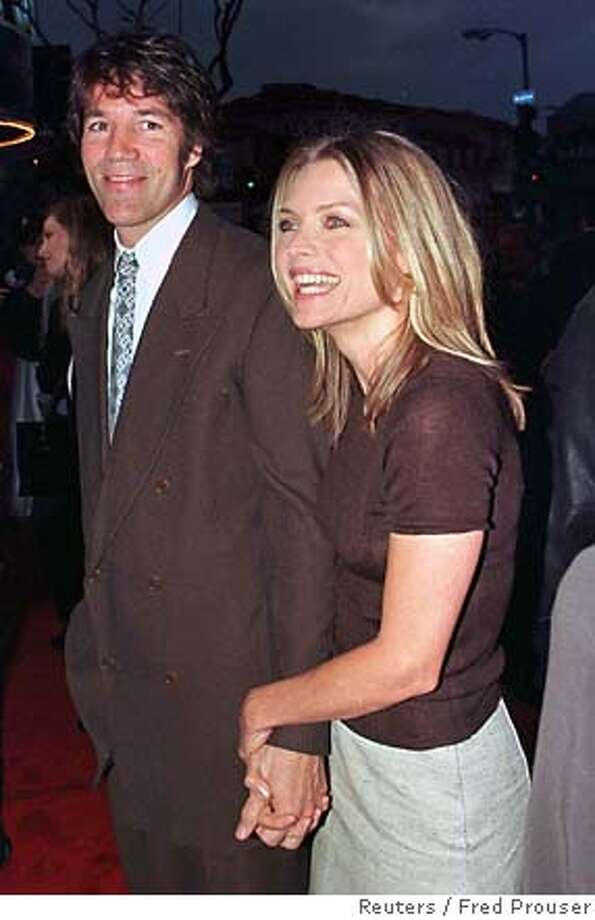 Michelle Pfeiffer and husband David E. Kelley are among those with Hawaii property, but they're trying to sell their beachfront home, which is being offered for $12.9 million. Reuters photo, 1999, by Fred Prouser