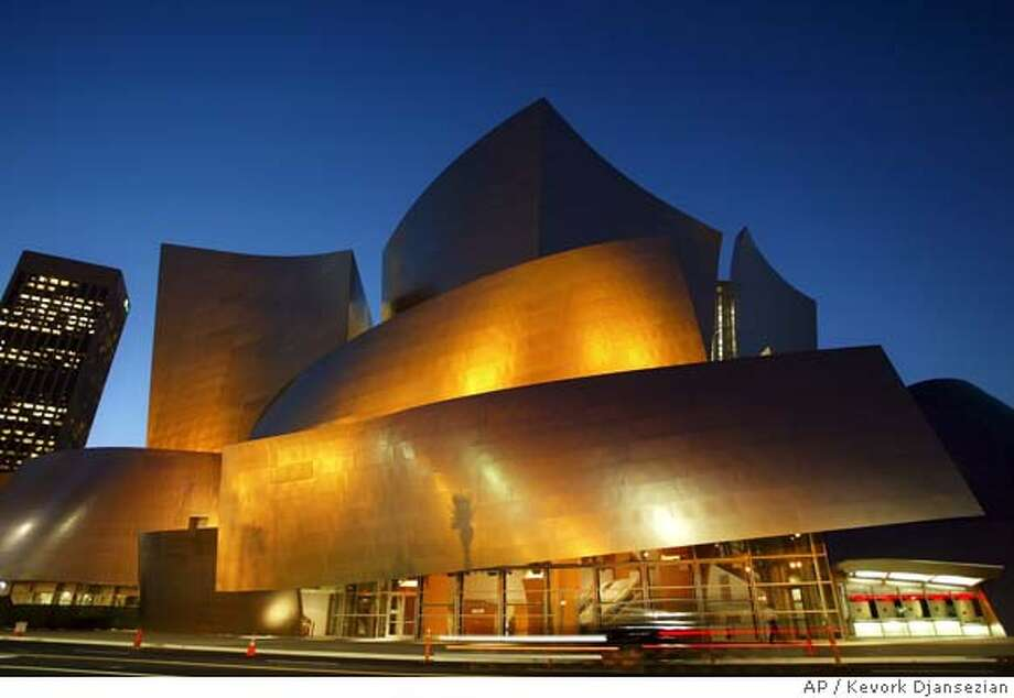 ** FOR USE ANYTIME **The new Walt Disney Concert Hall, designed by renowned architact Frank Gehry, is silhouetted against the twilight sky Tuesday evening, Oct. 14, 2003, in downtown Los Angeles. The 16-year struggle to build one of the city's most distinctive landmarks officially ends with an Oct. 23 debut concert. (AP Photo/Kevork Djansezian) CAT FOR USE ANYTIME Photo: KEVORK DJANSEZIAN
