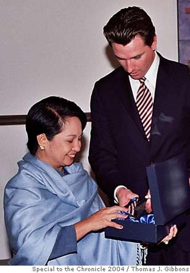 Left to Right: President Arroyo, Maror Gavin Newsom and Charlotte Shultz at USF. Ran on: 11-28-2004  Photo caption Photo: Thomas J. Gibbons