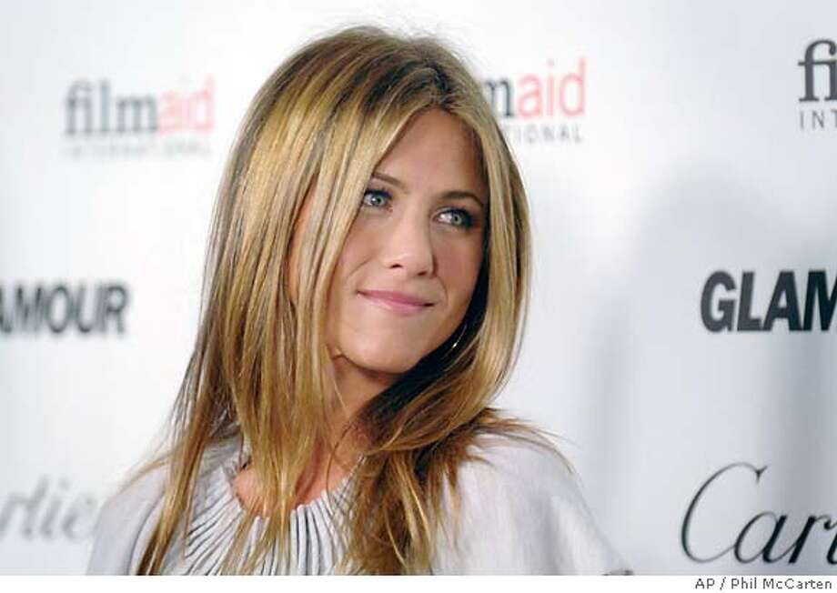 "Actress Jennifer Aniston who co-directed the short film ""Room 10"" attends the Glamour Reel Moments event held at the Directors Guild of America on Monday, Oct. 16, 2006, in Los Angeles. (AP Photo/Phil McCarten) Photo: PHIL MCCARTEN"
