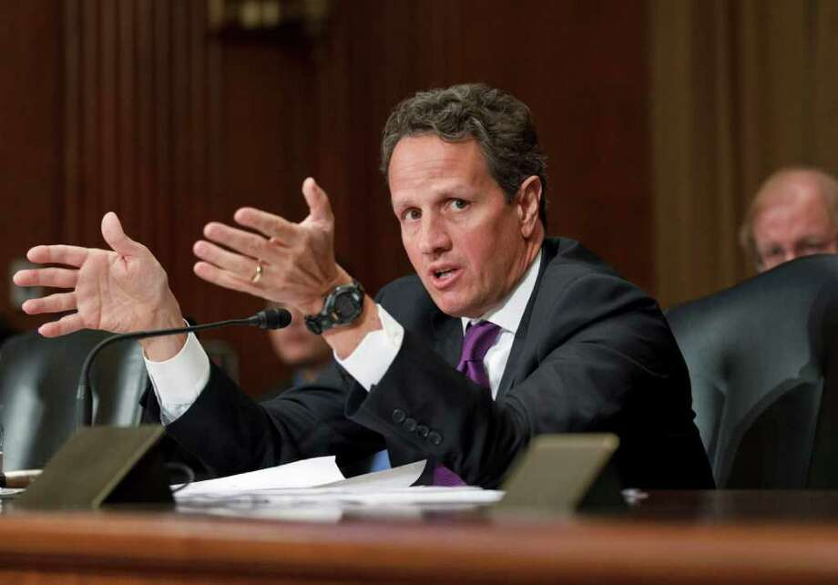 Treasury Secretary Timothy Geithner testifies on Capitol Hill in Washington, Tuesday, Feb. 14, 2012, before the Senate Finance Committee hearing on President Barack Obama's fiscal 2013 federal budget.   (AP Photo/J. Scott Applewhite) Photo: J. Scott Applewhite