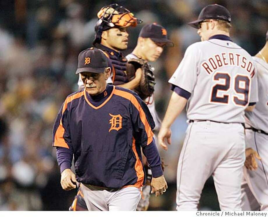 Detroit Tigers manager Jim Leyland walks back to the dugout after a conference with his pitcher Nate Robertson and infield in the 4th inning. Oakland Athletics and Detroit Tigers in Game One of the American League Championship Playoffs at MacAfee Coliseum. Photo by Michael Maloney / San Francisco Chronicle on 10/10/06 in Oakland,CA MANDATORY CREDIT FOR PHOTOG AND SF CHRONICLE/ -MAGS OUT Photo: Michael Maloney
