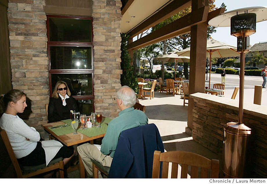 Sarah Cannon, Betsy Cannon and Martin Cannon (left to right) dine outside at Three Degrees, a new restaurant in Tiburon, CA. Ran on: 10-08-2006  The interior of Three Degrees in Tiburon, the first restaurant to open in that town since Bush senior was in office. Photo: Laura Morton
