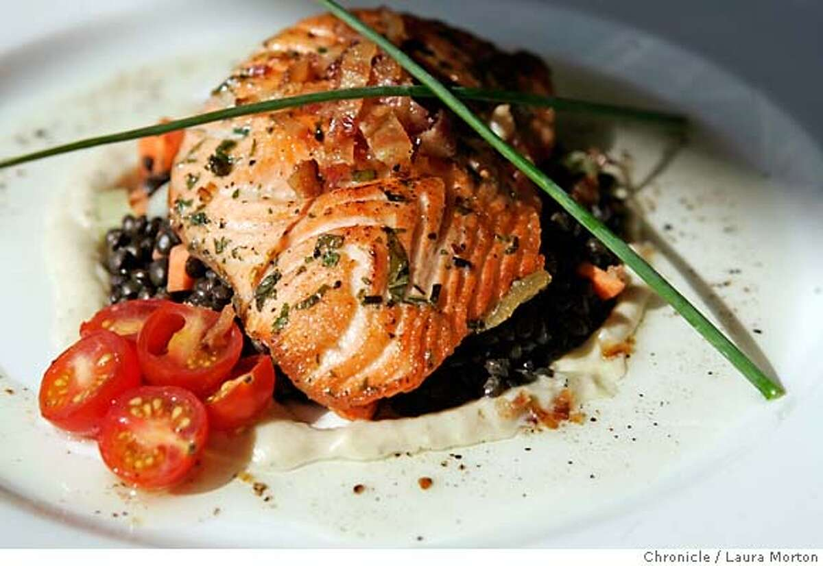 Scottish salmon with beluga lentils, creamy leeks and bacon sherry vinaigrette. Chronicle photo by Laura Morton