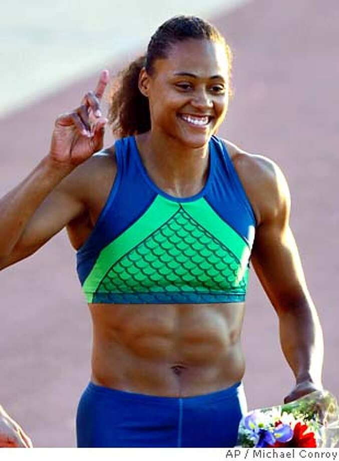 "Marion Jones smiles after winning the women's 100-meter dash at the U.S. Outdoor Track & Field Championships in Indianapolis, in this June 23, 2006 photo. The five-time Olympic medalist failed an initial drug test at the U.S. championships in June, people familiar with the results told The Associated Press on Friday, Aug. 18, 2006. Jones' ""A"" sample tested positive June 23 for the banned performance enhancer EPO at the event in Indianapolis, one source told the AP on condition of anonymity because the official results are not yet public. If a second, or ""B"" sample, also tests positive, one of the biggest stars of the Sydney Olympics would face a minimum two-year ban from competition. (AP Photo/Michael Conroy) A JUNE 23, 2006 FILE PHOTO Photo: MICHAEL CONROY"