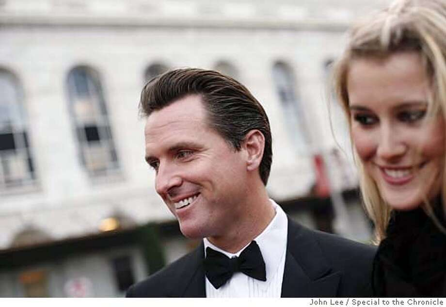 SEPT 6 - Opening night at the San Francisco Symphony. Vignettes of various fashion of San Francisco's well-heeled. Brittanie Mountz and Mayor Gavin Newsom. By JOHN LEE/SPECIAL TO THE CHRONICLE  Ran on: 09-21-2006  Symphony board of governors President John Goldman and his wife, Marcia Goldman, in a beaded chiffon chocolate gown by Max Nugus.  Ran on: 10-15-2006  Gavin Newsom and Brittanie Mountz  Ran on: 10-15-2006  Gavin Newsom and Brittanie Mountz Photo: JOHN LEE
