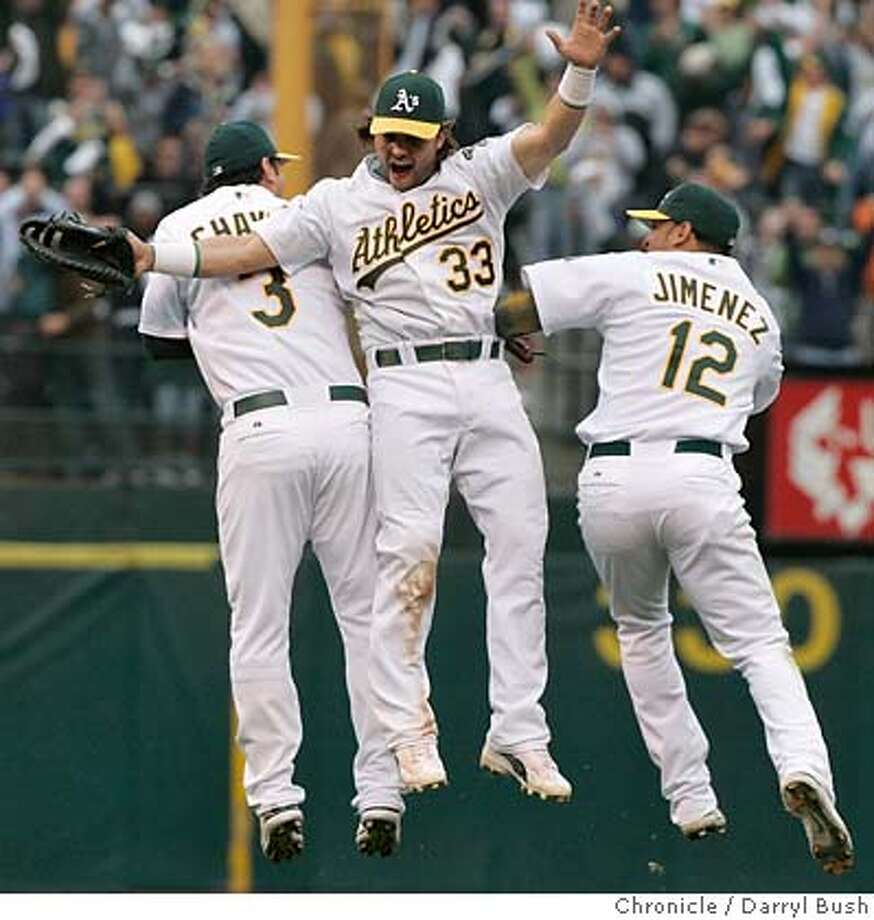 Eric Chavez, Nick Swisher, and D'Angelo Jimenez celebrate after the Oakland Athletics beat the Minnesota Twins 8-3. The Oakland Athletics play the Minnesota Twins in game three of the American League Divisional Series. Event on Friday, October 6, 2006 at McAfee Coliseum in Oakland, California. Darryl Bush / The Chronicle Photo: Darryl Bush