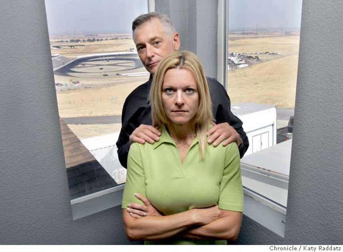 M&R_005_RAD.jpg SHOWN: Mark and Karin Rivard inside their house---one can see the Altamont Raceway in the background outside the window. Story is about a battle between the new owners of the Altamont Raceway and Mark Rivard and his family, who live in their dream home just 1,000 feet from the edge of the track. Rivard said his family has been greatly harrassed by lights, sound, and a helicopter buzzing his house. Rivard said the harrassment is retaliation for his efforts to put the brakes on the raceway, which he said is operating illegally. These photos shot on Sunday, Sept. 10, 2006, in East Alameda County. (Katy Raddatz/The S.F.Chronicle) **Kasrin Rivard, Mark Rivard Mandatory credit for photographer and the San Francisco Chronicle/ -Mags out