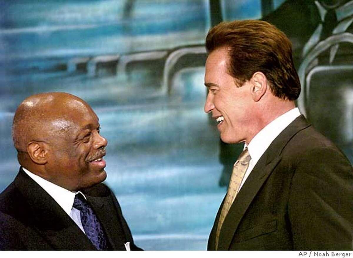 Former San Francisco Mayor Willie Brown, left, introduces California Gov. Arnold Schwarzenegger at a breakfast honoring civil rights leader Dr. Martin Luther King, Jr. on Monday, Jan. 16, 2006, in San Francisco. (AP Photo/Noah Berger)