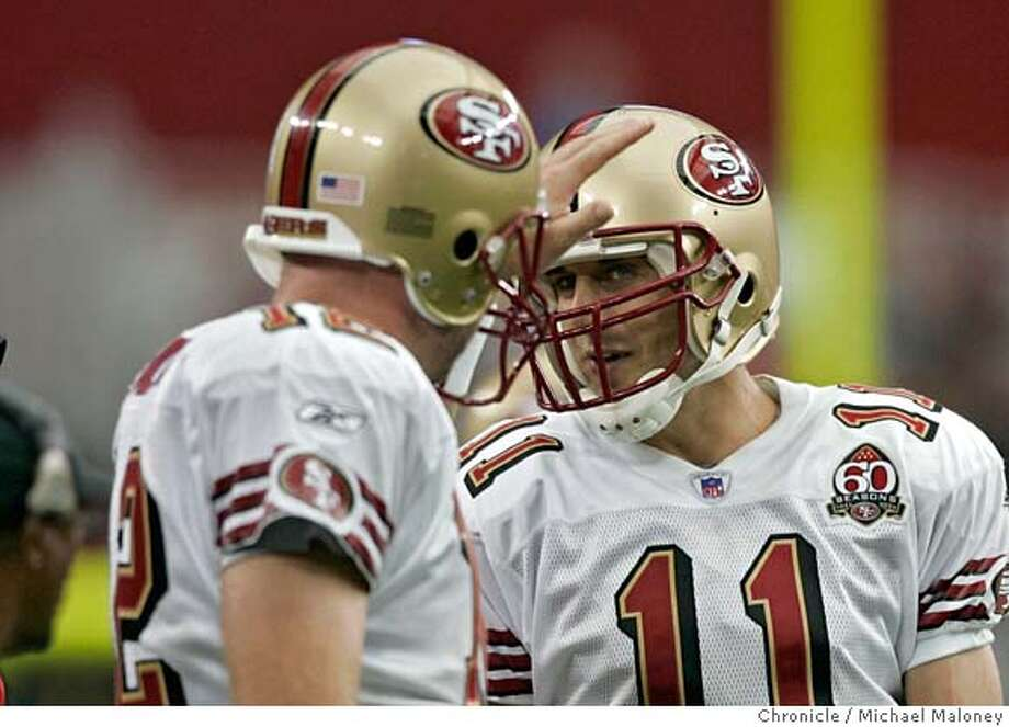 49ers QB Trent Dilfer (#12) gives 49ers QB Alex Smith (#11) a pat on the head in the 3rd qtr.  San Francisco 49ers vs Arizona Cardinals at the new Cardinals Stadium in Glendale, Arizona.  Photo by Michael Maloney / San Francisco Chronicle on 9/10/06 in Glendale,AZ MANDATORY CREDIT FOR PHOTOG AND SF CHRONICLE/ -MAGS OUT Photo: Michael Maloney