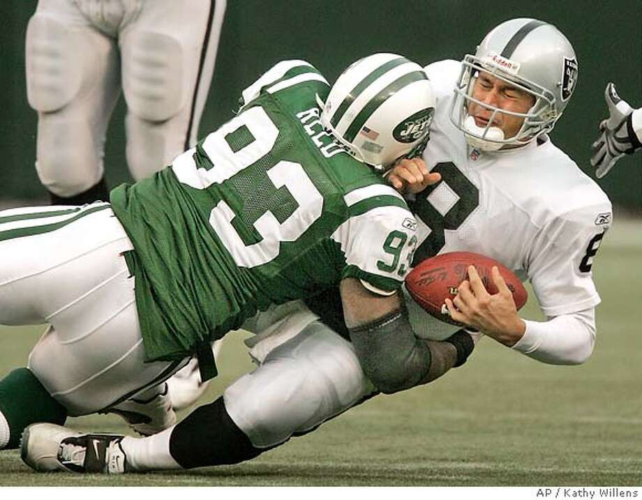 New York Jets defensive tackle James Reed sacks Oakland Raiders quarterback Marques Tuiasosopo (8) in the fourth quarter of the Jets 26-10 victory over the Raiders, Sunday, Dec. 11, 2005, at Giants Stadium in East Rutherford, N.J. (AP Photo/Kathy Willens) Photo: KATHY WILLENS