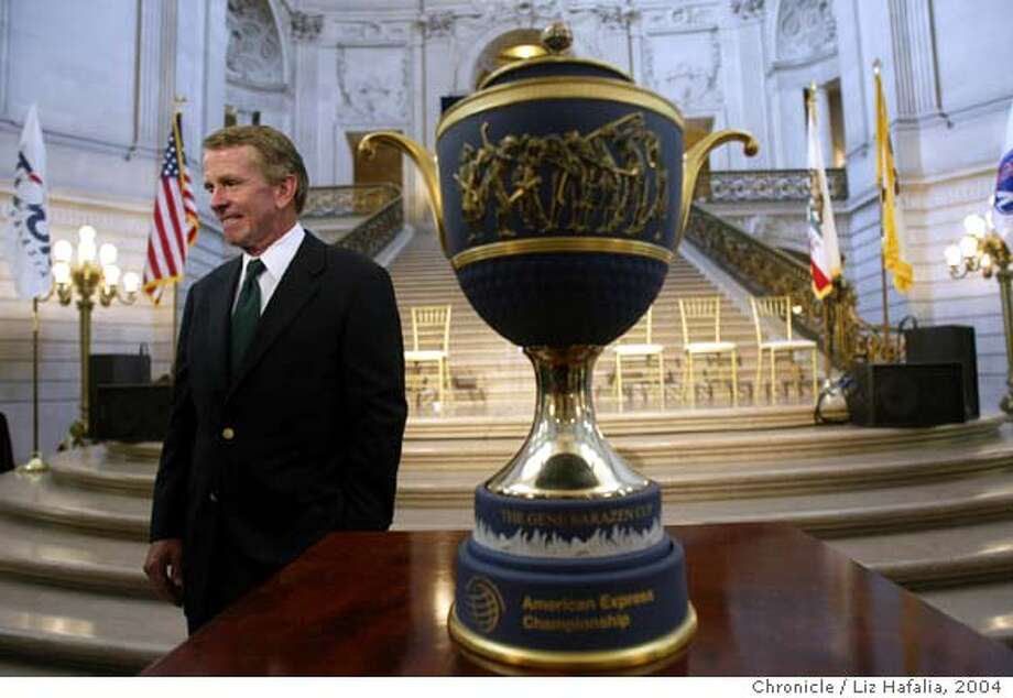PGA tour commissioner Tim Finchem announces at the City Hall Rotunda that the 2005 American Express Golf Championship will be held on San Francisco's Harding Park. Trophy is in the right middle. Shot on 6/21/04 in San Francisco. LIZ HAFALIA / The Chronicle Photo: LIZ HAFALIA