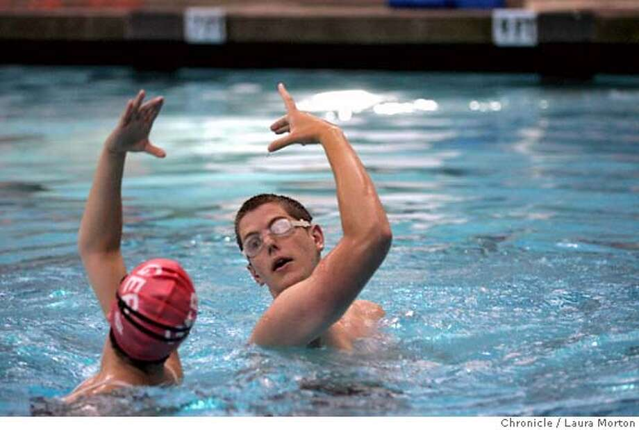 synchro_15003_lkm.jpg Michele Kraus (left) and Stephen Houghton (right), members of the mostly male synchronized swimming team the San Francisco Tsunami, practice a routine at the Martin Luther King Recreation Center in San Francisco, CA. Laura Morton/The Chronicle *** Michele Kraus  *** Stephen Houghton MANDATORY CREDIT FOR PHOTOGRAPHER AND SAN FRANCISCO CHRONICLE/ -MAGS OUT Photo: Laura Morton