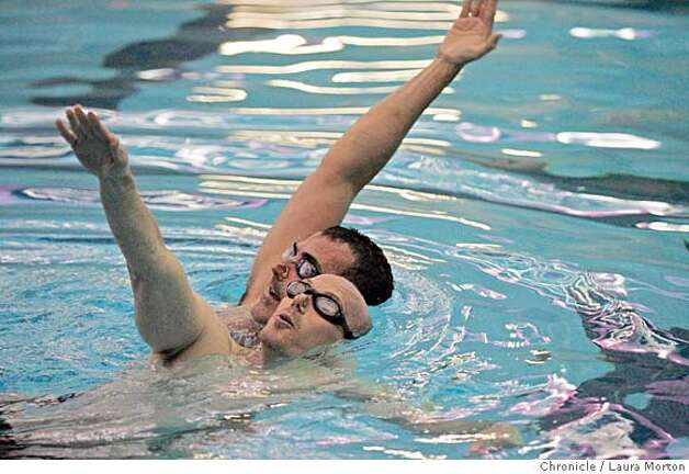Tsunami synchronized swimming team practice a routine at the martin