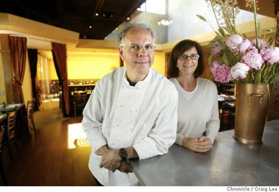Eccolo restaurant in Berkeley at 1820 Fourth Street. The chef/owner, Christopher Lee (left), has been at Chez Panisse for more than 20 years went on his own to start this restaurant with his wife Janet Hankinson (right). Photo of Christopher Lee and Janet Hankinson in the dining room of their Eccolo restaurant.  Event on 6/10/04 in Berkeley. Craig Lee / The Chronicle Photo: Craig Lee
