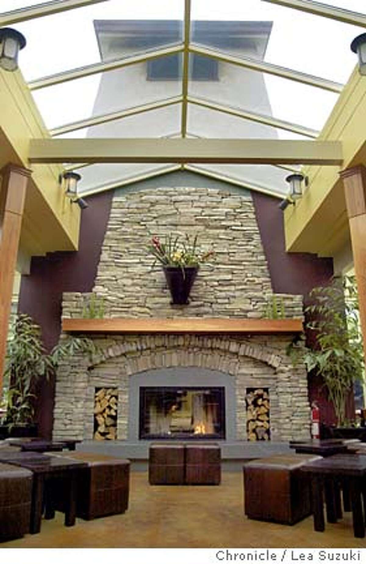 The fireplace commands the center of the restaurant and has a little seating area in front of it. The Park Chalet (restaurant behind the beach chalet). Please get pictures of the fireplace, also people outside on the adarondack chairs. For food, please get the hamburger, crab cocktail and the beer sampler. Photo taken on 06/30/04, in San Francisco, CA. Photo By LEA SUZUKI / The San Francisco Chronicle