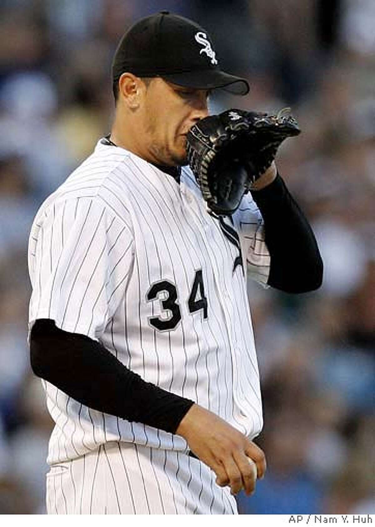 Chicago White Sox starting pitcher Freddy Garcia wipes his face after New York Yankees' Bobby Abreu's single during the first inning of a baseball game at U.S. Cellular Field, Tuesday, Aug. 8, 2006 in Chicago.(AP Photo/Nam Y. Huh)