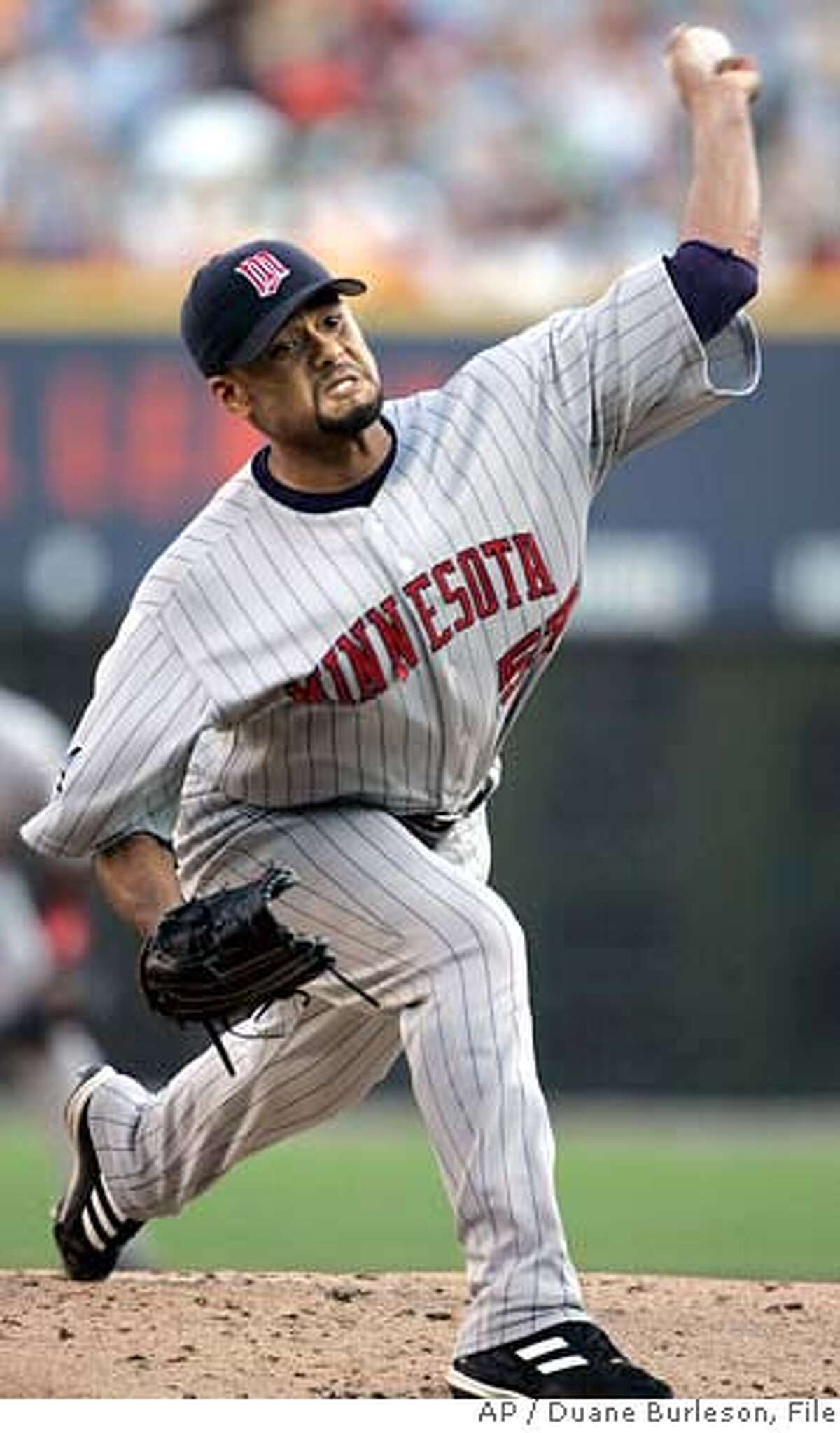 Minnesota Twins starter Johan Santana pitches against the Detroit Tigers in the first inning of a baseball game Wednesday, Aug. 9, 2006, in Detroit. (AP Photo/Duane Burleson)