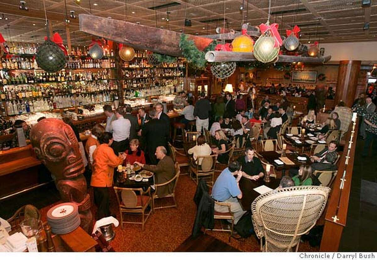 d16tradervics_186_db.jpg The main room for drinks or dining, with bar (left) in background of Trader Vic's restaurant, on Golden Gate Ave. 12/22/04 in San Francisco Darryl Bush / The Chronicle Ran on: 01-16-2005 Drinks and dining in the main room at Trader Vic's.