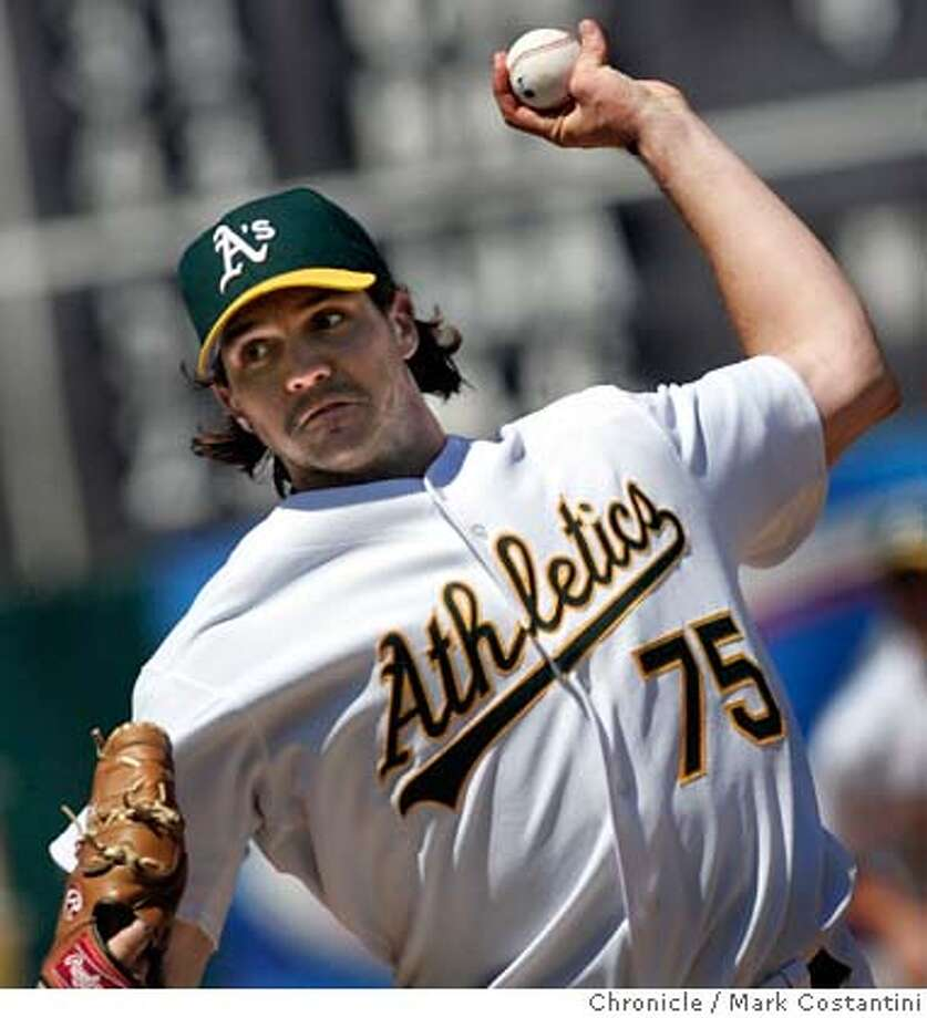 ATHLETICS_097_mc.jpg  A's pitcher Barry Zito and the eight inning.  A'S V. CHICAGO WHITE SOX AT THE OAKLAND COLISEUM. Photograph by Mark Costantini/S.F. Chronicle. Ran on: 07-04-2005  Barry Zito has been the very symbol of the resilient, never-quit A's, going eight innings in winning Sunday. Ran on: 07-04-2005 MANDATORY CREDIT FOR PHOTOG AND SF CHRONICLE/ -MAGS OUT Photo: Mark Costantini