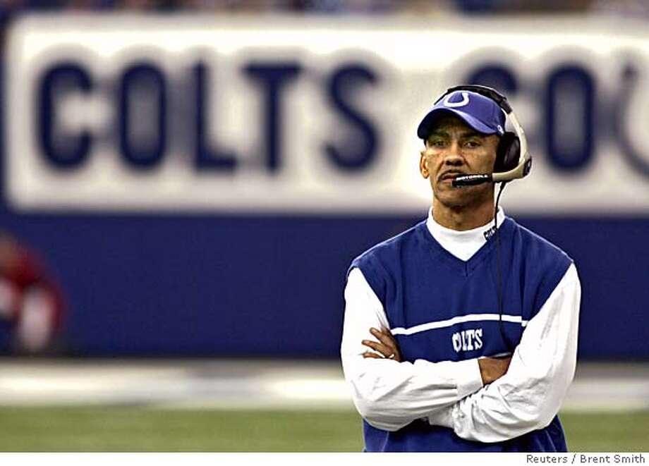Indianapolis Colts coach Tony Dungy stands at his team's sideline during the third quarter of NFL play against the San Diego Chargers at the RCA Dome in Indianapolis December 18, 2005. San Diego won 26-17 to hand the Colts their first loss of the season. REUTERS/Brent Smith 0 Photo: BRENT SMITH
